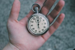 Hand with a clock in it as time management tool
