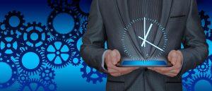 a man holding clock Prioritizing vs Multitasking