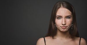 Woman scanned by facial recognition device