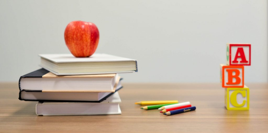 school desk with books